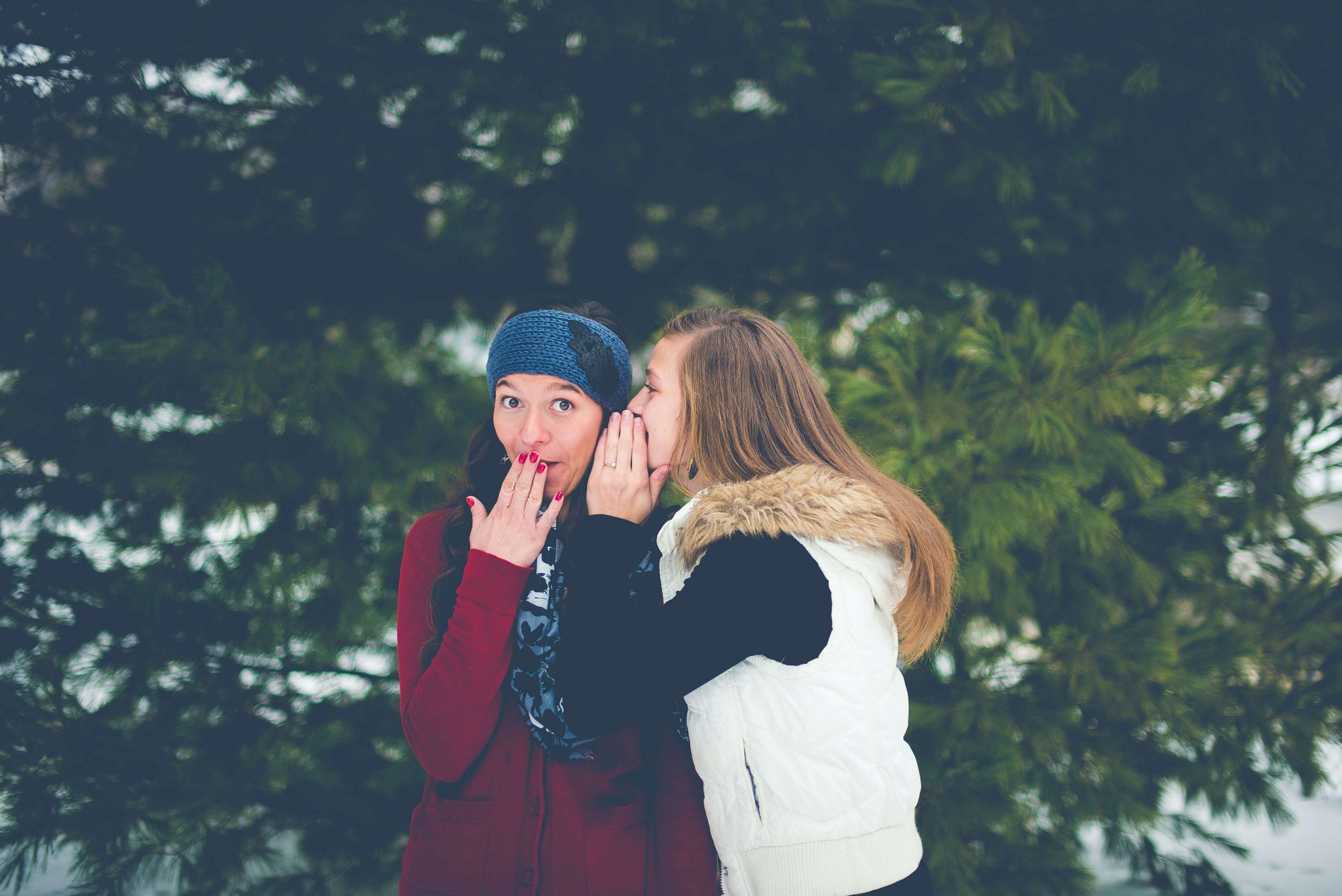 Two girls telling a shocking secret|www.parentinghighschoolers.com