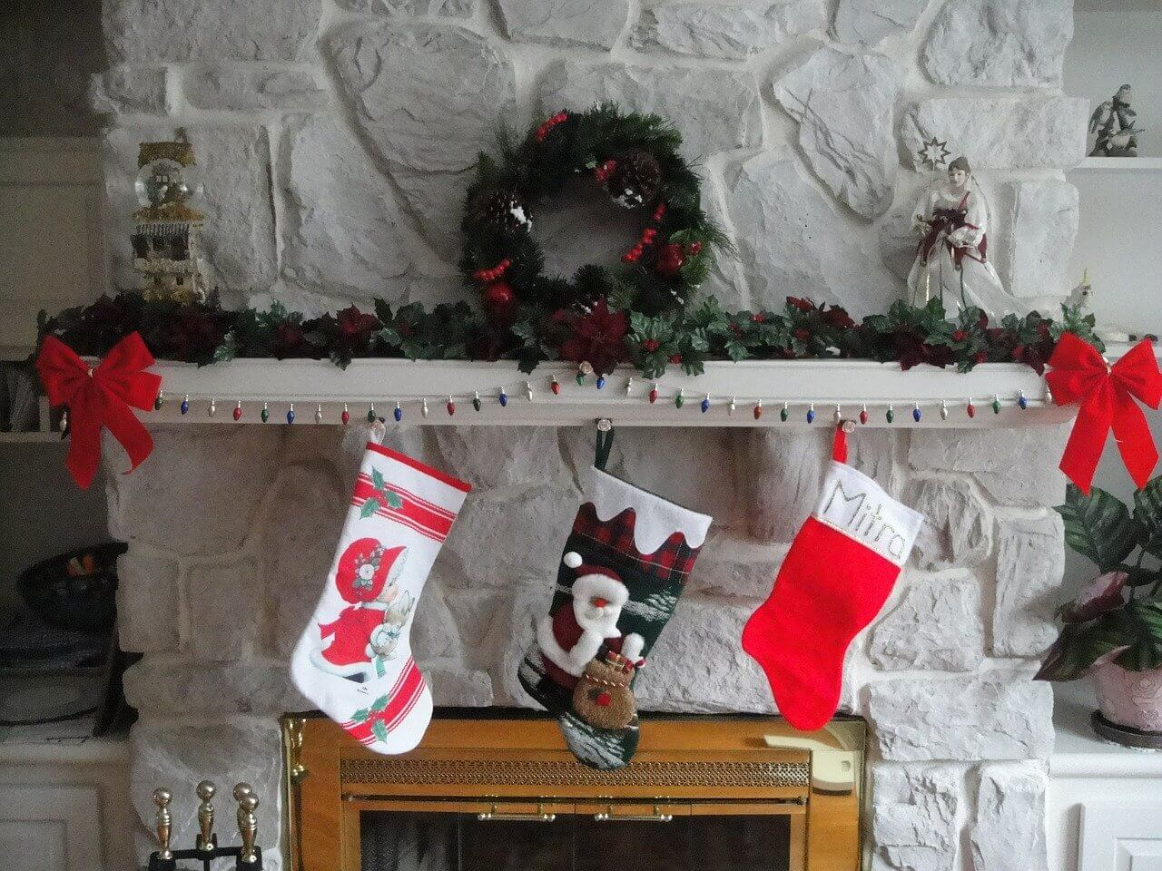 Three stockings hanging over a stone fireplace|www.parentinghighschoolers.com