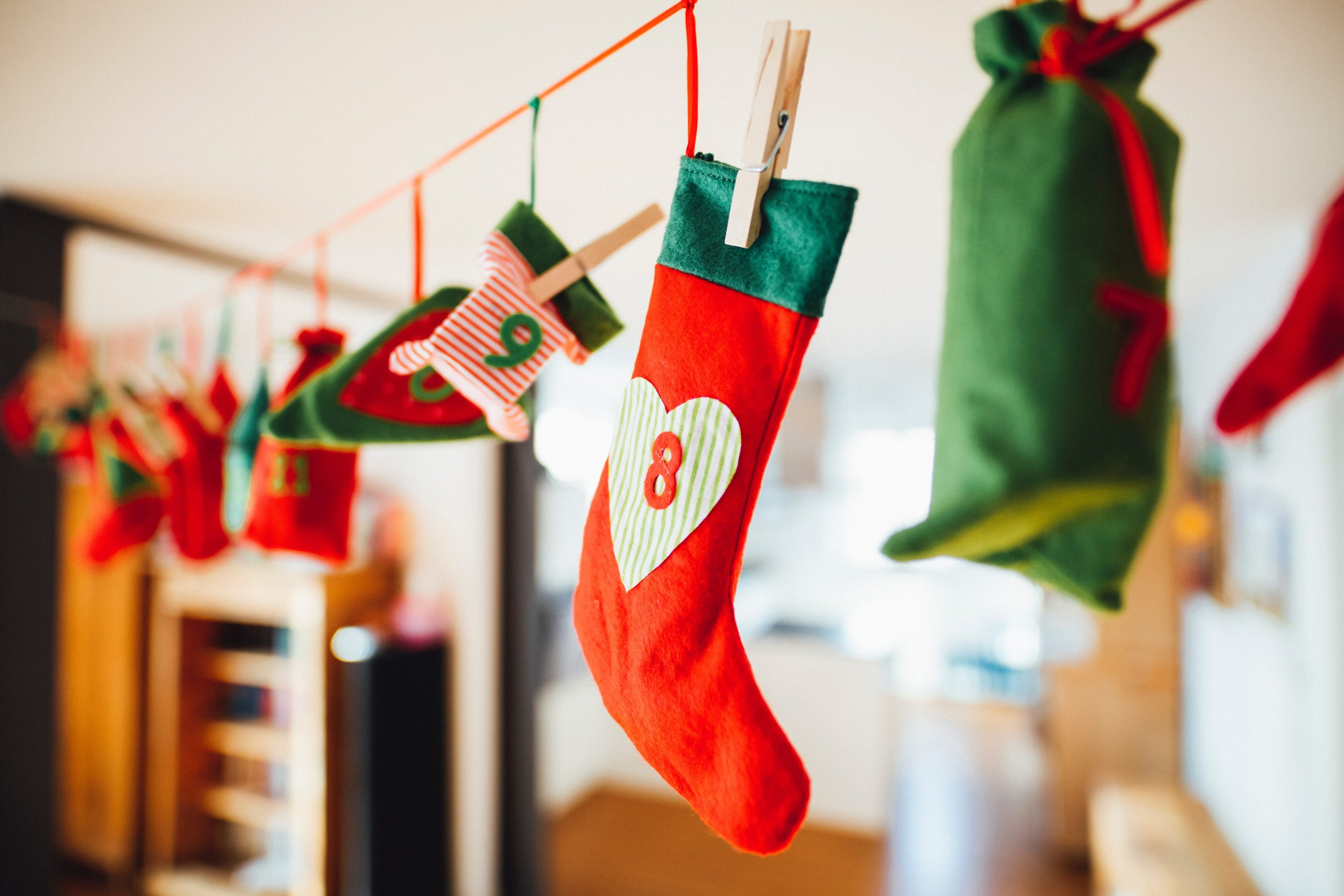 Advent stockings hanging on a line|www.parentinghighschoolers.com
